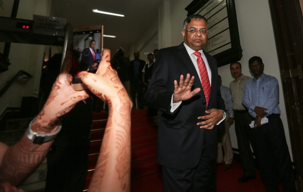 Natarajan Chandrasekaran (R), newly appointed chairman of Tata Group, exits after speaking to the media at Bombay House, the Tata Group head office in Mumbai.