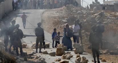 Israel detains 10 Palestinians in West Bank raids, injures dozens
