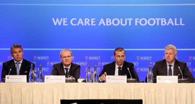 UEFA President Aleksander Ceferin (2R), Deputy Secretary General Giorgio Marchetti (2L), Chief Refereeing Officer Roberto Rosetti (L) and Managing Director of Communications Phil Townsend attend a press conference in Dublin on Dec. 3, 2018. (AFP)