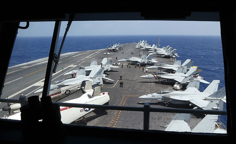 Fighter jets on board the U.S. Navy aircraft carrier USS Carl Vinson (CVN 70) are prepared for patrols off the disputed South China Sea on March 3, 2017. (AP Photo)