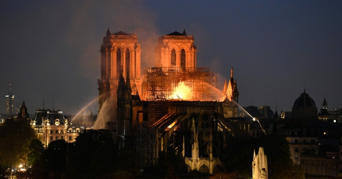 In this file photo taken on April 15, 2019 firefighters douse flames rising from the roof at Notre-Dame Cathedral in Paris. (AFP Photo)