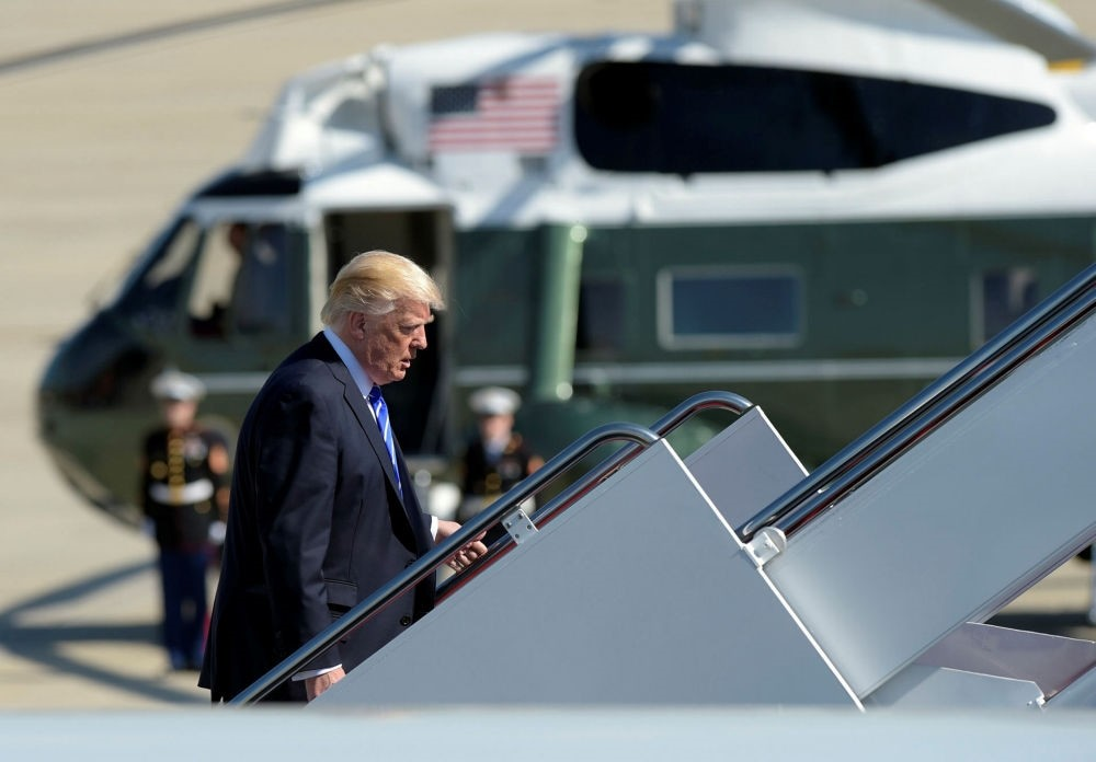 U.S. President Donald Trump walks up the steps of Air Force One at the Andrews Air Force Base, May 17.