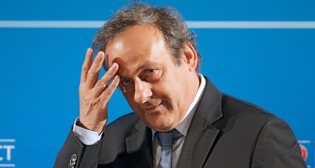 In this Feb.22, 2014 file photo, UEFA President Michel Platini arrives at a press conference, one day prior to the UEFA EURO 2016 qualifying draw in Nice, southeastern France. (AP Photo)