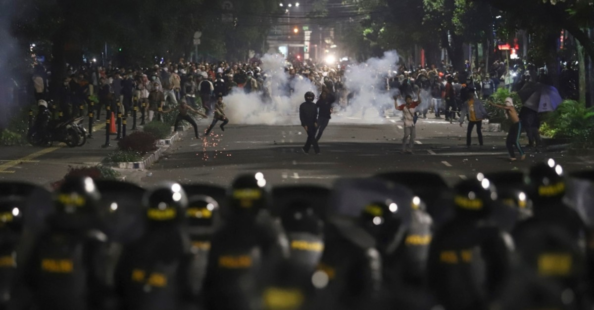 Supporters of Indonesian presidential candidate Prabowo Subianto clash with the police in Jakarta, Indonesia, early Wednesday, May 22, 2019. (AP Photo)