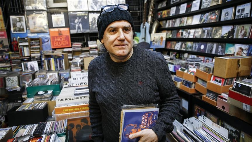 Su00fcleyman u00d6zyu0131ldu0131ru0131m holds David Bowie's ,Space Oddity, record at his shop, Shades in Ankara's u00c7ankaya district that sells cassettes, CDs and vinyl LPs, many of which are relatively hard to find, on Feb. 2, 2019.