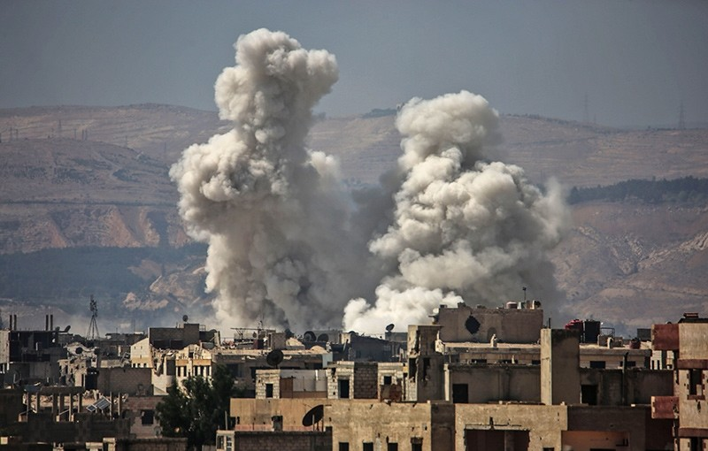 Smoke billows following bombardment on September 29, 2017, in an opposition-held town, on the outskirts of the capital Damascus (AFP Photo)