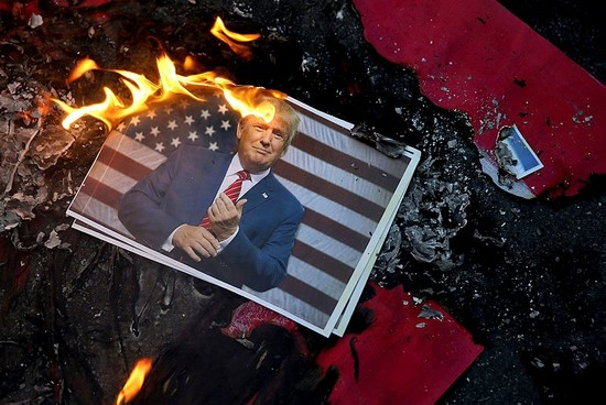 A portrait of Trump is set on fire by Iranian protesters during a rally against his decision to recognize Jerusalem as the capital of Israel, in Tehran, Dec. 11, 2017. (AP Photo)