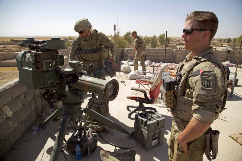 In this Aug. 20, 2017 file photo, U.S. Army soldiers stands next to a guided-missile launcher, a few miles from the frontline, in the village of Abu Ghaddur, east of Tal Afar, Iraq. (AP Photo)