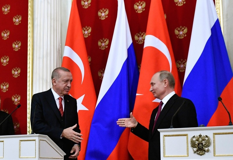 President Recep Tayyip Erdou011fan, left, and Russian President Vladimir Putin prepare to shake hands after their joint news conference following the talks in the Kremlin in Moscow, Russia, Wednesday, Jan. 23, 2019. (Pool Photo via AP)