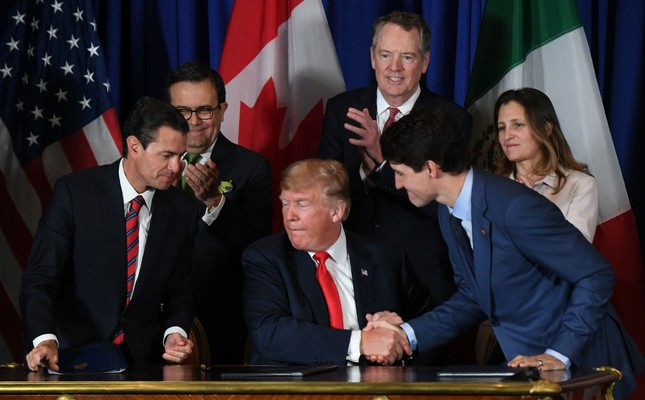Left to right, Mexican President Enrique Pena Nieto, U.S. President Donald Trump and Canadian Prime Minister Justin Trudeau sign a new free trade agreement in Buenos Aires, on the sidelines of the G20 summit, Nov. 28.