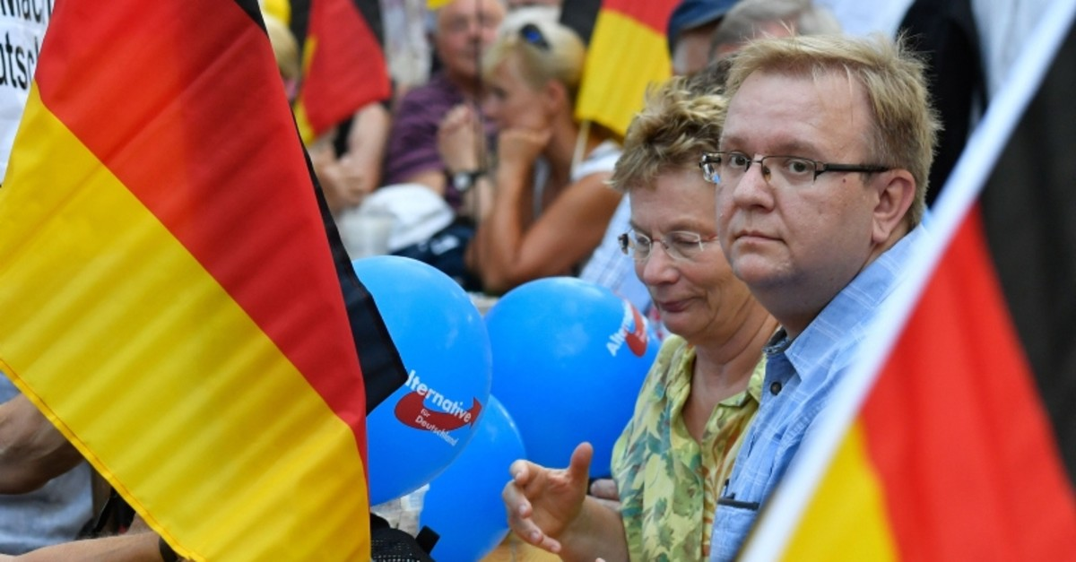 People withGerman flags and balloons attend an election rally of the far-right party Alternative for Germany (AfD) in Koenigs Wusterhausen, eastern Germany on August 30, 2019. (AFP Photo)