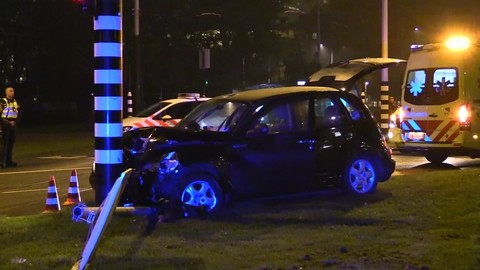 This image taken from video shows a car crashed up against a lamp post in Amsterdam, Sept. 28, 2017. (AP Photo)