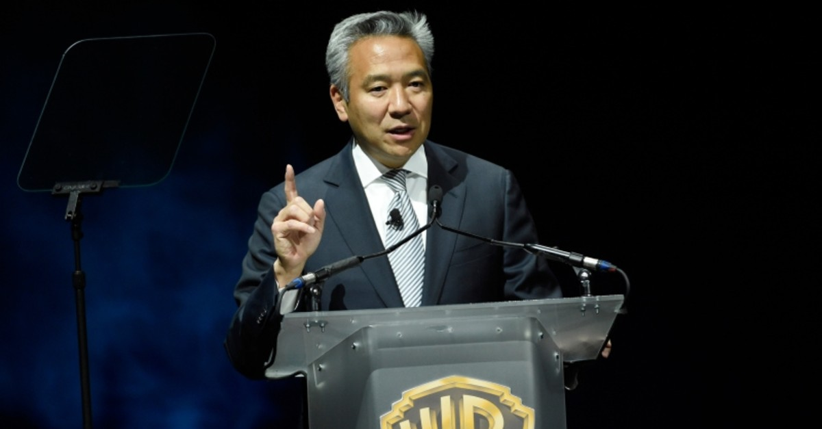 This April 21, 2015 file photo shows Kevin Tsujihara, chairman and CEO of Warner Bros., during the Warner Bros. presentation at CinemaCon 2015 in Las Vegas. (AP Photo)