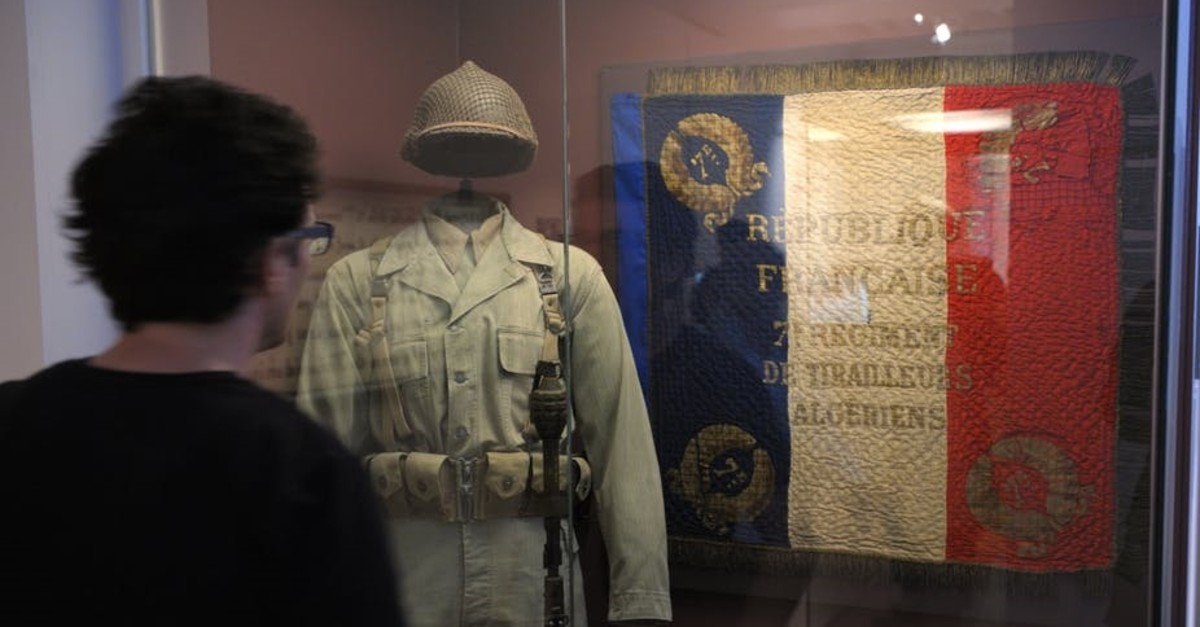 The flag reads ,French Republic - Algeria 7th Sharpshooter Regiment, in an exhibition on France's history (Reuters Photo)