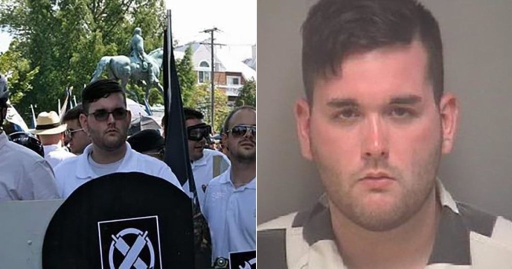 The photo (L), taken by the New York Daily News , shows James Alex Fields Jr. stands with a handful of men, all dressed similarly in the usual Vanguard America uniform.