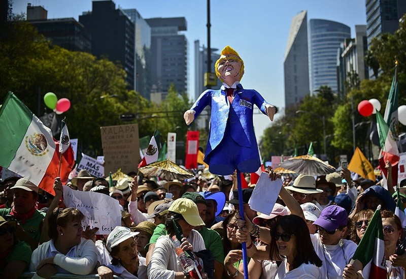 Thousands of Mexicans take part in an anti-Trump march in Mexico City, on February 12, 2017 (AFP Photo)