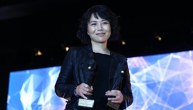 Chinese actress Wen Qi accepts The Best Film award for Angels Wear White at the 54th Antalya Film Festival, Antalya, Turkey, Oct. 27, 2017. (AA Photo)