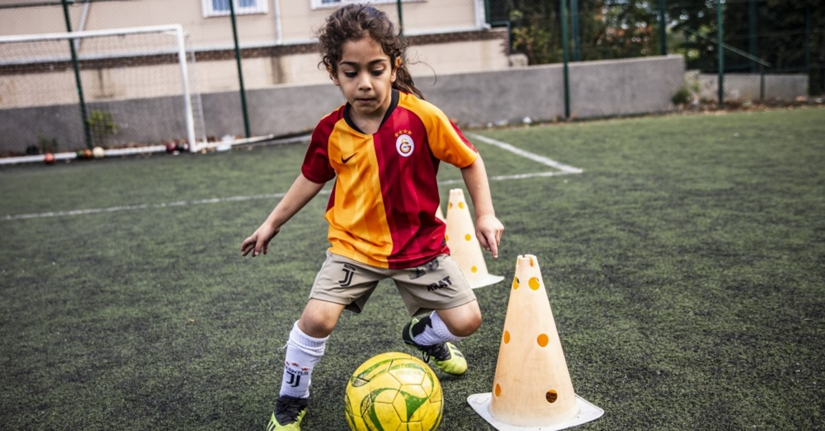 Hosseini trains at Galatasaray's football school for youngsters in Istanbul.