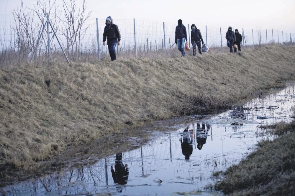 Afghan migrants trek their way to the Serbian border with Hungary close to Hajdukovo, 150 kilometers north of Belgrade, Serbia, Feb. 17, 2015.