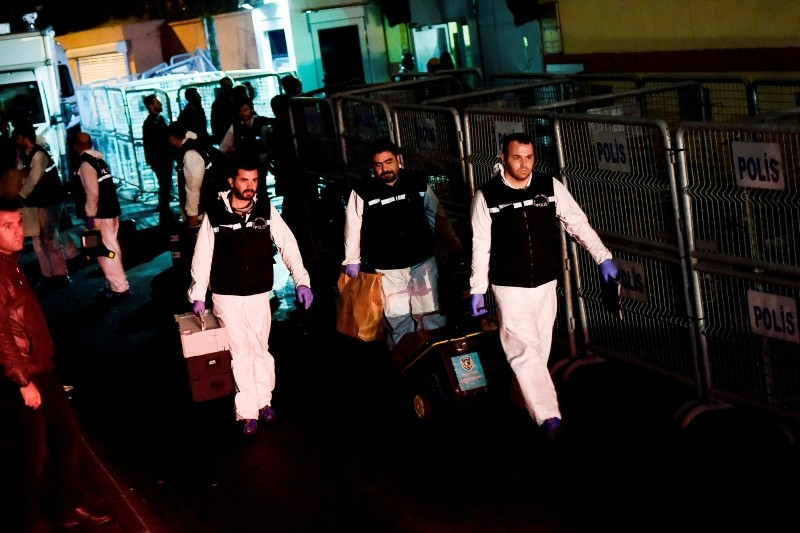 Turkish forensic police officers leave after searching evidence at the Saudi Arabiain Consulate on October 18, 2018 in Istanbul. (AFP Photo)