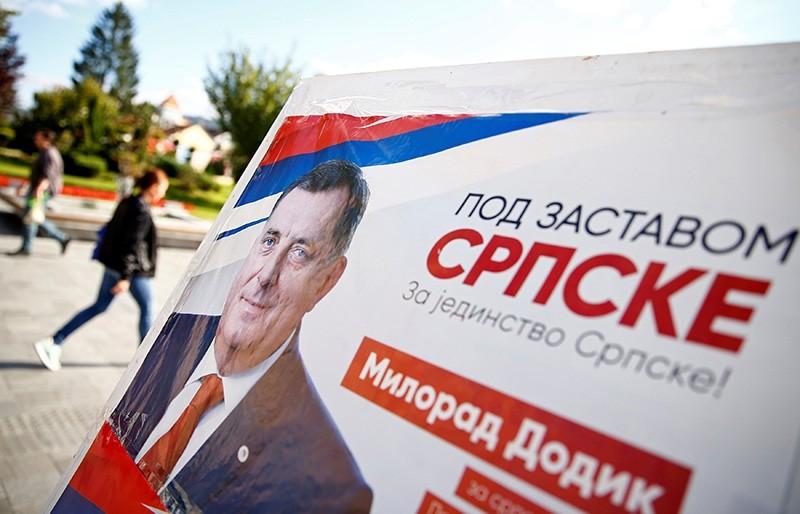 People pass by Milorad Dodik's pre-election poster in Banja Luka, Bosnia and Herzegovina, Sept. 26, 2018. (Reuters Photo)
