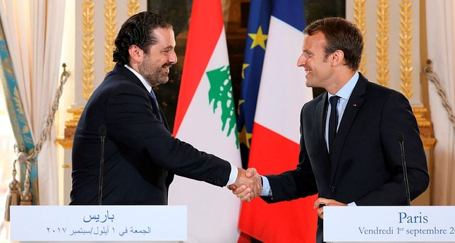 This file photo taken Sept. 1, 2017 shows French President Emmanuel Macron R shaking hands with Lebanese Prime Minister Saad Hariri during a press conference at the Murat Lounge in the Elysee Palace in Paris, France. AFP Photo