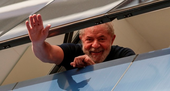 Brazilian former president Luiz Inacio Lula da Silva waves from a window of the Metallurgical Union, in Sao Bernardo do Campo, Sao Paulo state, Brazil, on April 07, 2018. (AFP Photo)