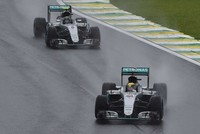 World champion Lewis Hamilton won a rain-hit race on the Interlagos circuit for his first win in Brazil ahead of Mercedes team-mate Rosberg to keep his title hopes alive. The plaudits go to Max...