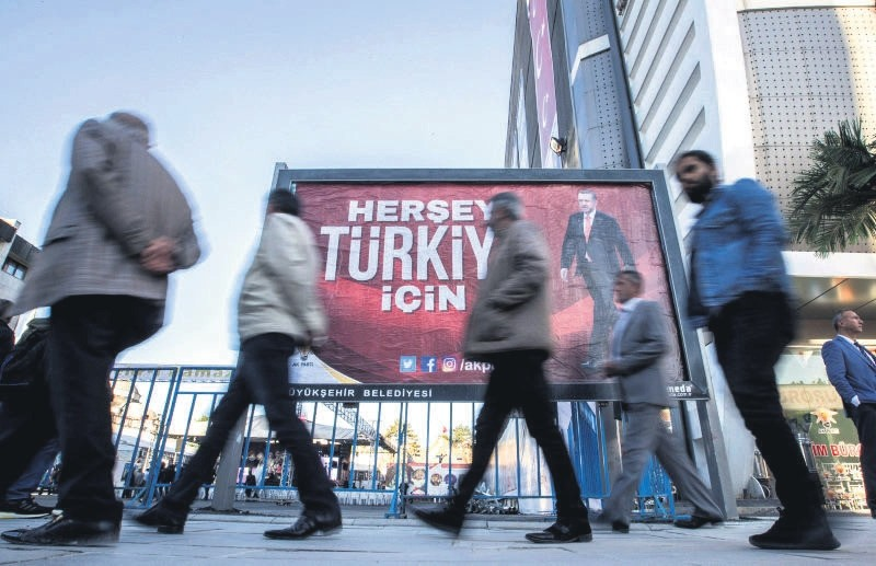 People walk by a billboard of President Recep Tayyip Erdou011fan that reads ,Everything for Turkey,, Van, Eastern Turkey, May 16. (EPA Photo)
