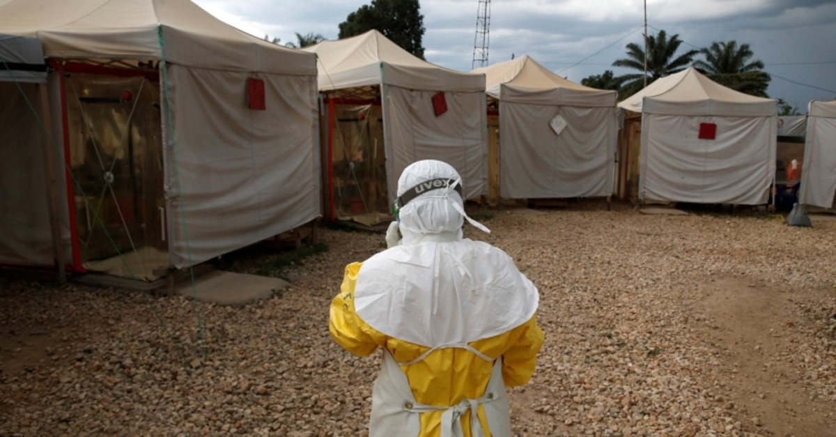 A health worker wearing Ebola protection gear enters the Biosecure Emergency Care Unit (CUBE) at The Alliance for International Medical Action Ebola treatment center in Beni, in Democratic Republic of Congo, March 30, 2019. (Reuters))