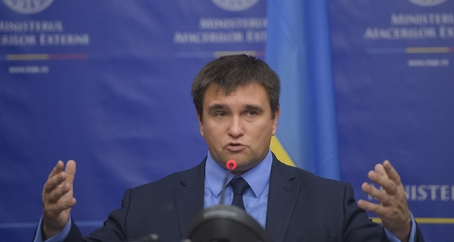 Ukrainian Foreign Minister Pavlo Klimkin gestures during joint statements with Romanian counterpart Teodor Melescanu in Bucharest, Romania, Friday, Oct. 13, 2017 AP Photo