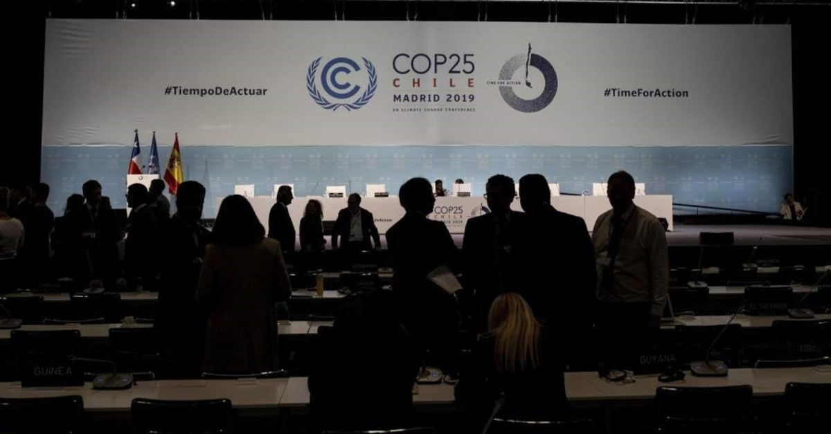 COP25 party members talk ahead of the closing plenary in Madrid, Dec. 15, 2019. (AP Photo)