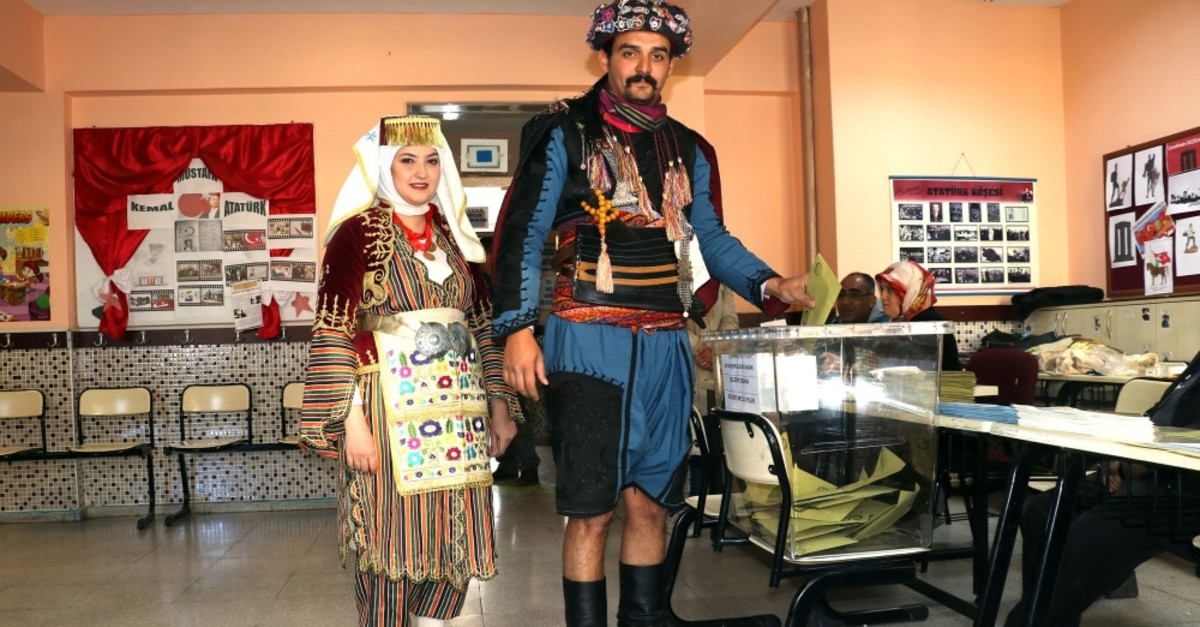 A couple wearing traditional costumes casted their votes in the southwestern province of Aydu0131n, March 31, 2019.