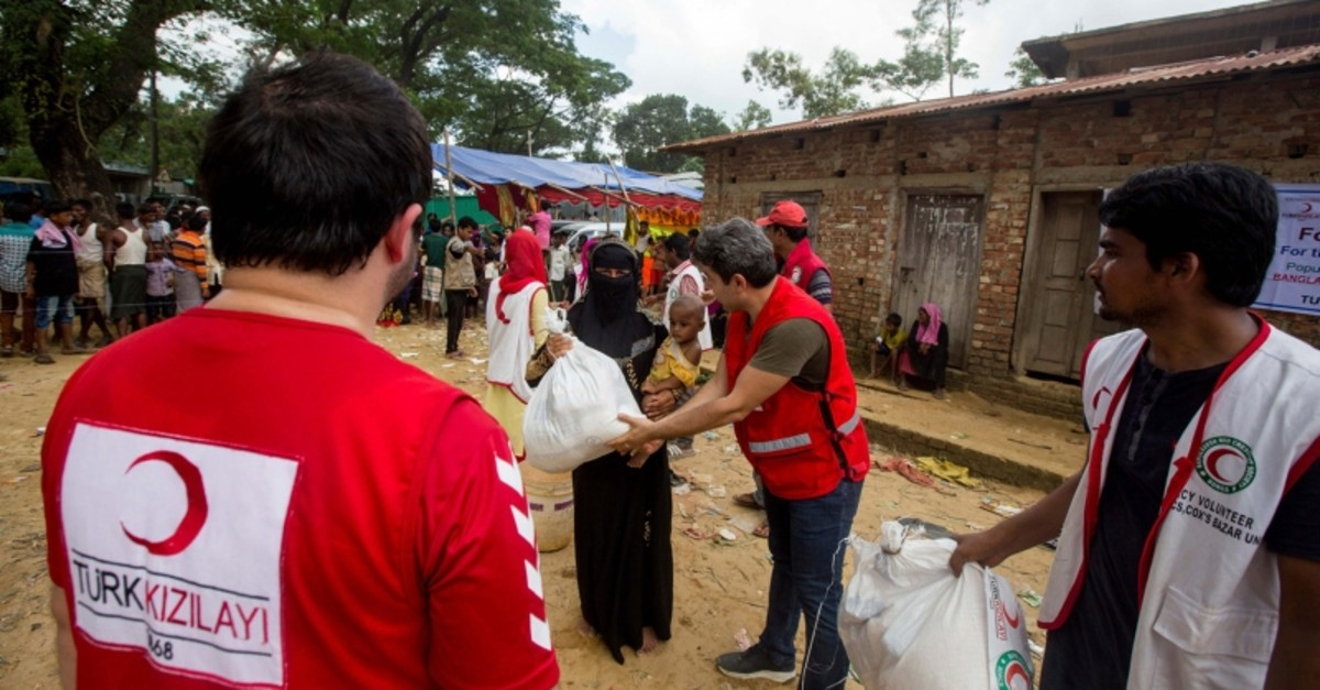 This file photo shows Turkish Red Crescent volunteers help Rohingya refugees fleeing violence in Myanmar, in Bangladesh, Dec. 2017