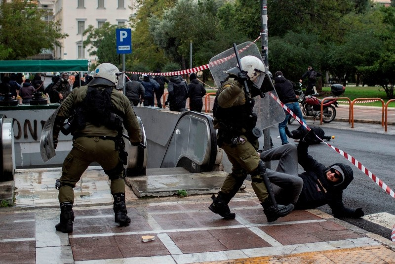 Police clash with protesters on Dec. 6, 2018 in Athens, during a demonstration  to commemorate the 10th anniversary of fatal shooting of a teenager which sparked major riots in Greece, in 2008. (AFP Photo)