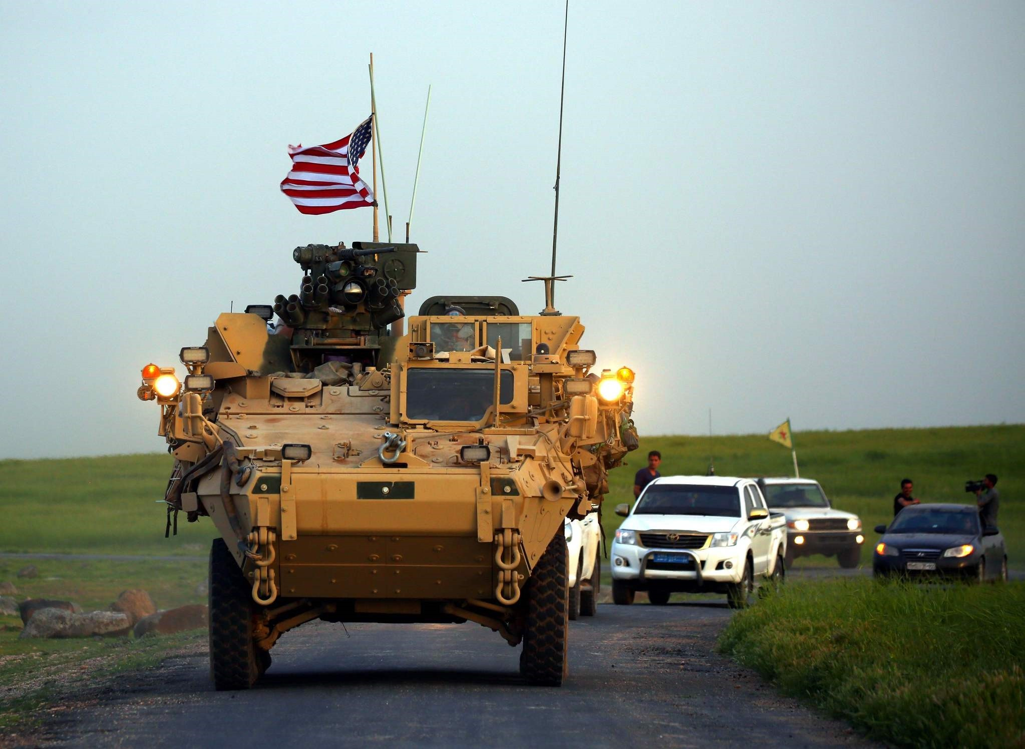 U.S. forces, accompanied by Syrian YPG terrorist, seen driving their armoured vehicles near the northern Syrian village of Darbasiyah, on the border with Turkey on April 28.