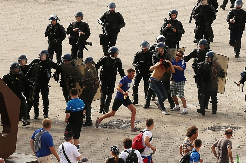 French riot police move in to detain Russian soccer fans after violence broke out ahead of Russia-England match in Marseille, France. (AP File Photo)
