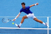 Djokovic returns from elbow injury with win over Thiem ahead of Australian Open