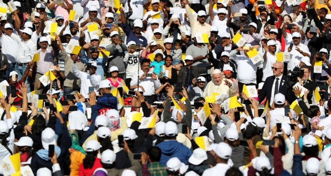 Pope Francis waves to the crowd as he arrives to lead Mass for an estimated 170,000 Catholics at the Zayed Sports City Stadium on Feb. 5, 2019. (AFP Photo)