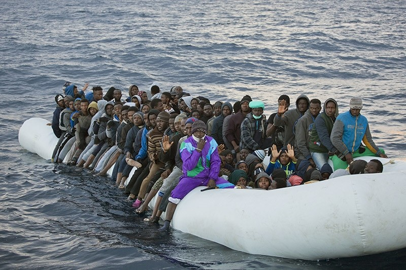 In Feb. 3, 2017 file photo, migrants and refugees wait to be helped by members of the Spanish NGO Proactiva Open Arms, as they crowd aboard a rubber boat sailing out of control in Mediterranean Sea about 21 miles north of Sabratha, Libya. (AP Photo)