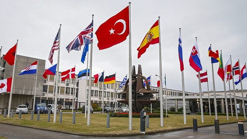 Flags of NATO member countries fly in front of the NATO headquarters in Brussels, Belgium, 28 July 2015. (EPA Photo)