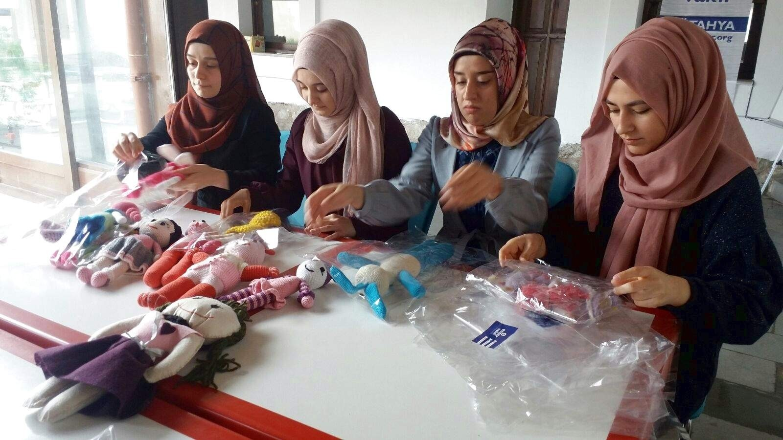 Volunteers package knitted dolls at the Ku00fctahya branch  of the Ensar Foundation.