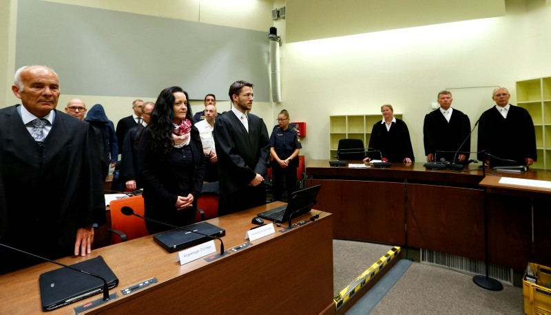 Beate Zschaepe (2L) and her lawyers Hermann Borchert (L) and Mathias Grasel wait in a Munich courtroom before her trial as the only surviving member of neo-Nazi cell NSU behind a string of racist murders, in Germany, on July 11, 2018. (AFP Photo)
