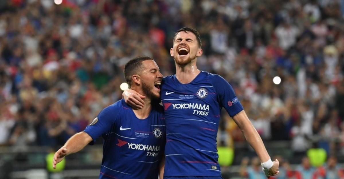 Chelsea's Belgian midfielder Eden Hazard (L) celebrates with Chelsea's Italian midfielder Jorginho after scoring a goal. (AFP Photo)