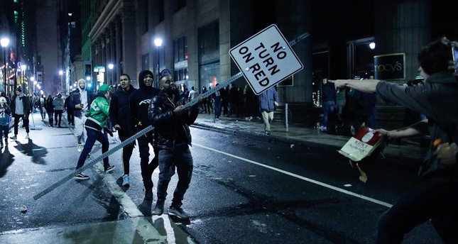 A man carries a traffic signal as Philadelphia Eagles fans celebrate victory in Super Bowl LII game against the New England Patriots in Philadelphia, Pa., Feb. 4, 2018. (Getty Images/AFP)