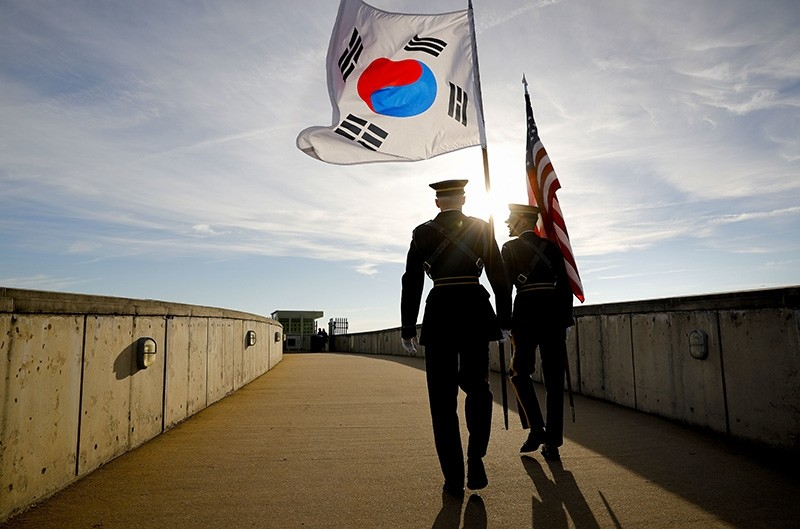 Members of the Honor Guard carry U.S. and South Korea flags after participating in the 2018 Security Consultative at the Pentagon, co-hosted by Defense Secretary Jim Mattis and South Korean counterpart Jeong Kyeong-doo, Oct. 31, 2018. (AP Photo)