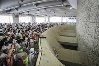In stifling heat, a Saudi security guard sprayed Muslim pilgrims with water as they advanced through Mina for the final rite of the hajj, the