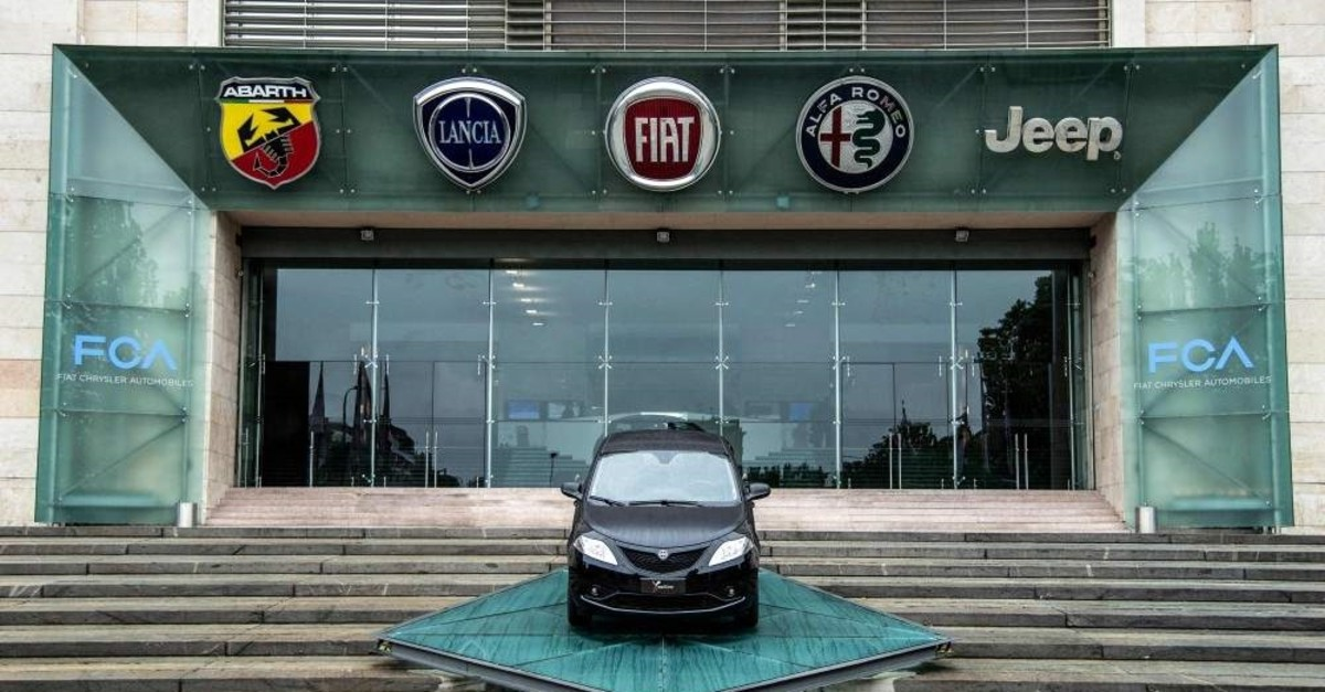 In this file photo taken on May 27, 2019, the logos of automobile companies (L-R) Abarth, Lancia, Fiat, Alfa Romeo and Jeep are pictured at the entrance to the Fiat Chrysler Automobiles (FCA) at the Fiat Mirafiori car plant in Turin, Italy. (AFP Photo)