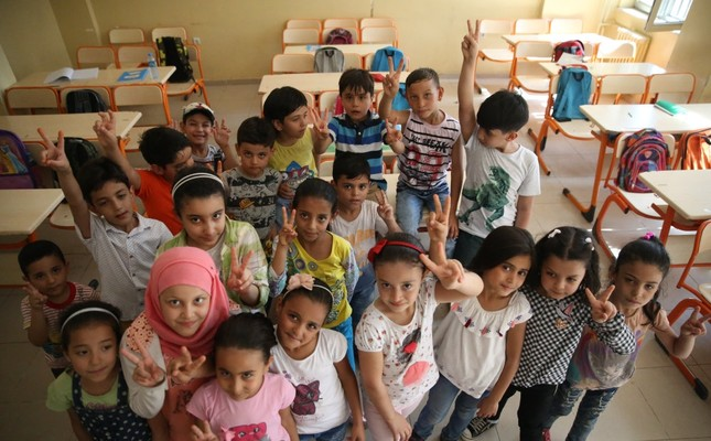 Syrian refugee children at a school in the southeastern city of Şanlıurfa. Turkey offers access to education, health and other public services for more than 3.5 million refugees from Syria.