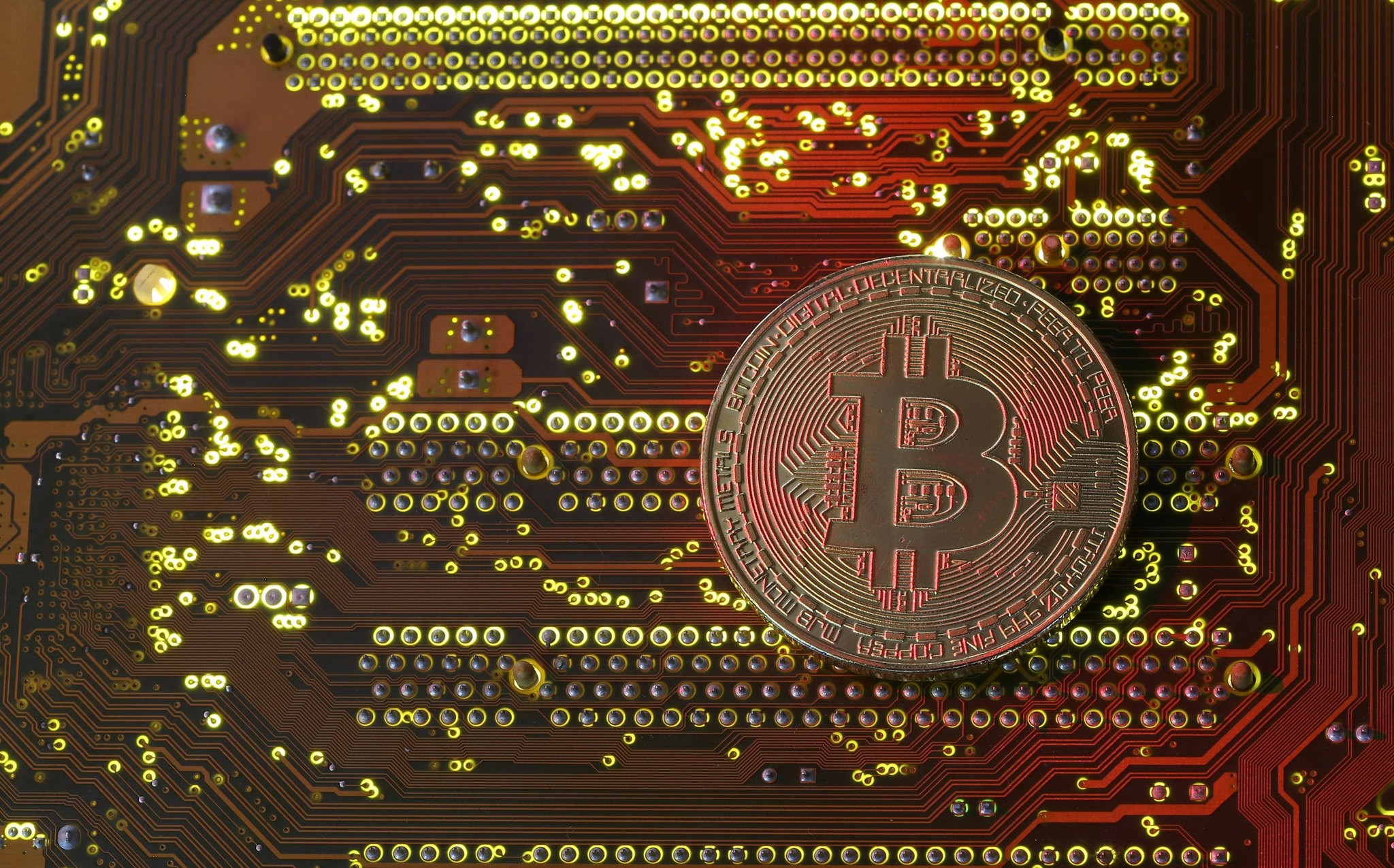 A copy of bitcoin standing on PC motherboard is seen in this illustration picture, October 26, 2017. (REUTERS Photo)
